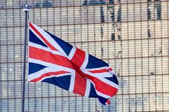 British Union - Flag Flying. British Union Flag Flying background of a high rise building Royalty Free Stock Photo