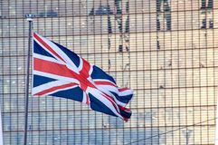 British Union - Flag Flying. British Union Flag Flying background of a high rise building Royalty Free Stock Photography