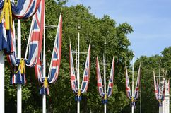 British Union Flags on The Mall. London. England. British Union Flags around the Queens Gardens at the end of The Mall outside Buckingham Palace. Westminster Stock Images