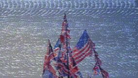 British Union Jack and American flags of the United States waving against blue sky. Bad signal VHS effect old tv British Union Jack and American flags of the stock footage
