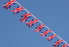 British Union Jack Bunting Flags. Against blue sky Stock Photos