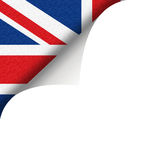 British Union Jack Flag. Partial view of the British Union Jack flag underneath a white page curl Stock Images