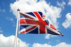 British Union Jack flag. British Union Jack flag against a blue sky, UK stock photo