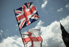 British Union Jack flag blowing in the wind. Stock Photos