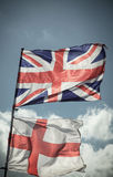 British Union Jack flag blowing in the wind. Stock Images
