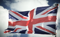 British Union Jack flag blowing in the wind. Royalty Free Stock Images