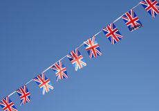 British Union Jack Flag Bunting Row. British Union Jack bunting flags against blue sky Stock Photos