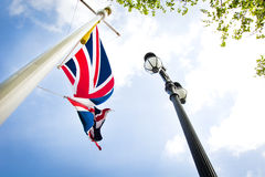 British Union Jack flag on cloudy sky Stock Images