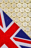 British Union Jack flag and currency. New pound coins. British Union Jack flag and currency - bimetallic one pound coins, introduced in March 2017. Overhead Royalty Free Stock Photo