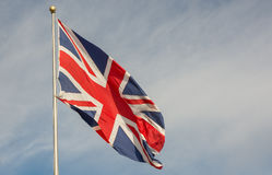 British Union Flag. British Union Jack flag flying from mast stock photo