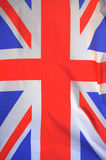 British Union Jack flag. Real British Union Jack flag blowing in the wind closeup Royalty Free Stock Image