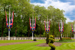 British Union Jack flags Mall, London, England. The British Union Jack flag at Saint James Park, the Mall and Buckingham Palace, London, UK Stock Photos