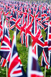 British United Kingdom UK Flags in a row with front focus and the further away symbols blurry with bokeh. The flags were set up on Stock Image