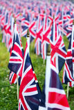 British United Kingdom UK Flags in a row with front focus and the further away symbols blurry with bokeh. The flags were set up on Royalty Free Stock Image