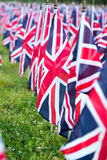 British United Kingdom UK Flags in a row with front focus and the further away symbols blurry with bokeh. The flags were set up on Stock Photos