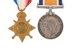 The British War Medal, 1914-18 with ribbon (Squeak), The 1914-15 Star (Pip). The British War Medal, 1914-18 with ribbon, silver vintage military medal (Squeak) Royalty Free Stock Photos