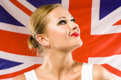 British woman holding the Jack Union flag Royalty Free Stock Photos