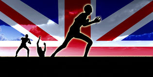 British Zombies. Zombies emerging from the ground with the Union Jack Flag Royalty Free Stock Photo