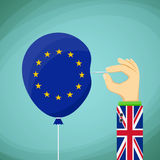 Briton with a needle in his hand and a balloon with the flag of Stock Image