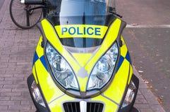 Britse die Politiefiets op een weg in Londen wordt geparkeerd Stock Foto