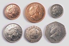 Britse muntstukken: hoofden stock afbeeldingen