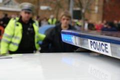 Britse politiewagen bij incident, stock foto