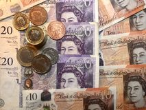 Britse ponden als achtergrond ¼ Œcoins van ï stock fotografie
