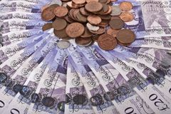 Britse ponden nota's en muntstukken Stock Afbeelding