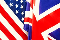 Britse vlag en de Vlag van de V.S. Relaties tussen landen Stock Afbeeldingen