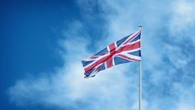 Britse Vlag met Wolken het Overgaan stock footage