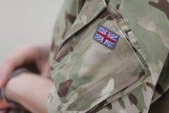 Britse vlag op een R.A.F.-eenvormige militair stock foto