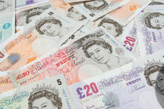 Britsh Pound Notes Currency. UK currency notes __ slight selective focus on foreground Royalty Free Stock Photos