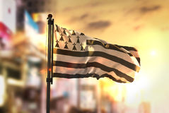 Brittany Flag Against City Blurred Background At Sunrise Backlig Royalty Free Stock Photo
