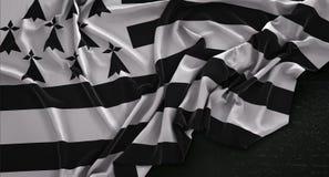 Brittany Flag Wrinkled On Dark-Hintergrund 3D übertragen Lizenzfreie Stockfotos