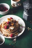 Brittany Galette or Pancake or Crepe for Breakfast with Caramelized Banana, Yogurt , Granola and Raspberries. French Crepe For Ch. Andeleur. on wooden background stock images