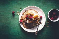 Brittany Galette or Pancake or Crepe for Breakfast with Caramelized Banana, Yogurt , Granola and Raspberries. French Crepe For Ch. Andeleur. on wooden background royalty free stock photos