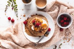 Brittany Galette or Pancake or Crepe for Breakfast with Caramelized Banana, Yogurt , Granola and Raspberries. French Crepe For Cha. Ndeleur on wooden background stock photos
