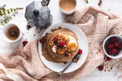 Brittany Galette or Pancake or Crepe for Breakfast with Caramelized Banana, Yogurt , Granola and Raspberries. French Crepe For Cha. Ndler  on wooden background stock image