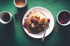 Brittany Galette or Pancake or Crepe for Breakfast with Caramelized Banana, Yogurt , Granola and Raspberries. French Crepe For Ch. Andeleur. on wooden background stock image