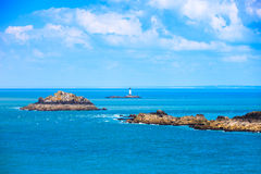 Brittany ocean panorama, islands and lighthouse Point du Grouin. Royalty Free Stock Photo