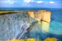 Brittisk Jurassic kustkrita staplar gammal Harry Rocks Dorset England UK öst av Studland som en målning Arkivbilder