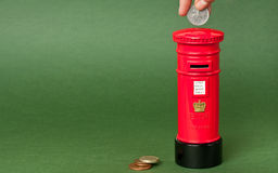 brittisk mailpostpiggybank Royaltyfria Foton