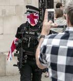 Brittisk polis Blended With Union Jack Flag Arkivfoto