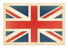 Brittisk portostämpel med den isolerade Storbritannien flaggan Fotografering för Bildbyråer