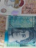 Brittiska bancknotes stänger sig upp, inklusive 5 pund anmärkning, 10 pund anmärkningar, 20 pund ett pund sterlinganmärkningar Royaltyfria Bilder