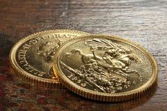 Brittiska guld- mynt Arkivfoton