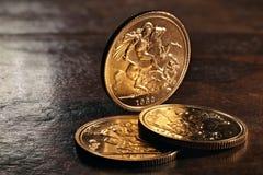 Brittiska guld- mynt Arkivbilder