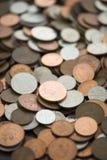brittiska mynt inramniner den fulla ett pund sterling Arkivbilder