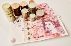 Brittiska pund på tabellen Royaltyfri Bild