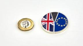 Brittiskt pund och Brexit mynt arkivfoto